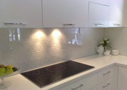 white back painted glass backsplash